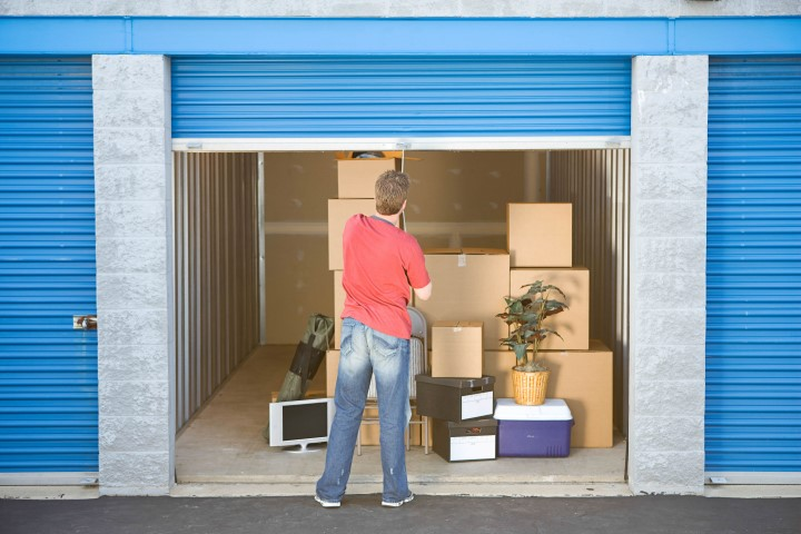Man loading storage unit